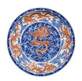 Rare iron-red and  underglaze blue 'Dragon' dish. Estimated £100,000- 150,000.