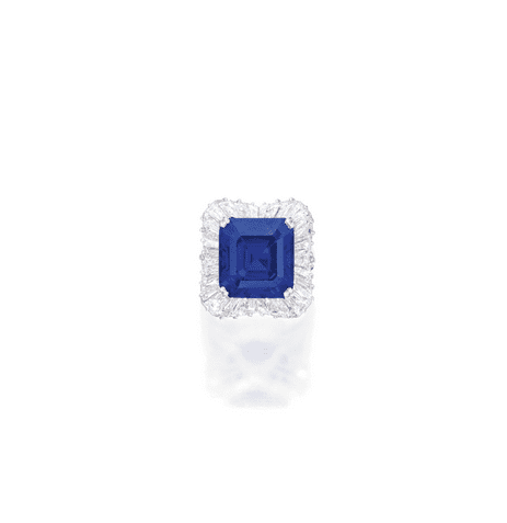 PROPERTY TO BE SOLD FOR THE BENEFIT OF A CHARITABLE FOUNDATION EXCEPTIONAL PLATINUM, SAPPHIRE AND DIAMOND RING Centering a square emerald-cut sapphire weighing 28.18 carats, framed by 32 tapered baguette diamonds, size 8, the mounting by Oscar Heyman & Brothers. Estimate 4,000,000 — 5,000,000 USD  LOT SOLD. 5,093,000 USD