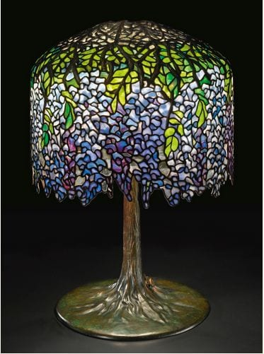 "PROPERTY FROM A DISTINGUISHED TENNESSEE FAMILY TIFFANY STUDIOS ""WISTERIA"" TABLE LAMP shade with small early tag impressed TIFFANY STUDIOS/NEW YORK underside of bronze armature on shade impressed 2267 and 6 top of base standard impressed 2267 and 6 base plate impressed TIFFANY STUDIOS/NEW YORK/2267 outer perimeter edge of underbase impressed 6 leaded glass and patinated bronze 26 1/2  in. (67.3 cm) high 18 1/2  in. (47 cm) diameter of shade circa 1901-1905 Estimate 300,000 — 500,000 USD"