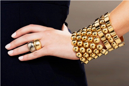 Two gold rings, by Cartier. Estimate: $1,500-2,000.  A wide gold bracelet. Estimate: $3,000-5,000. A retro gold bracelet. Estimate $2,500-3,500.
