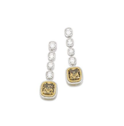 Lot  446 FANCY COLOURED DIAMOND AND DIAMOND EARRINGS Each set with a cushion-shaped fancy dark yellow-brown diamond weighing 6.15 carats and a cushion-shaped fancy dark brown-yellow diamond weighing 6.34 carats, each within a surround of brilliant-cut diamonds of yellow and near colourless tint, suspended from an articulated line of cushion-shaped and brilliant-cut diamonds, post and butterfly fittings.   Estimate 55,000 — 75,000 GBP