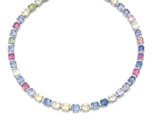 Lot 95 COLOURED SAPPHIRE AND DIAMOND NECKLACE Designed as a line of cushion-shaped sapphires of various hues, alternating with pairs of brilliant-cut diamonds, length approximately 420mm, Italian assay mark. Estimate 25,000 — 35,000 GBP