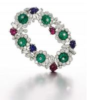 Garland brooch, set with carved emeralds,  rubies and sapphires