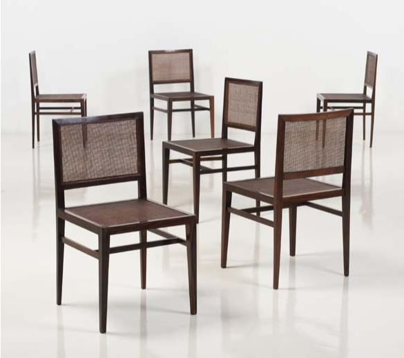 """Joaquim Tenreiro (1906-1992) Set of six chairs Mahogany and cane Label """"ava decoracoes ltda"""" under the chair Creation date: 1955 H 31,8 x L 17,3 x W 17,3 in €10,000-15,000"""