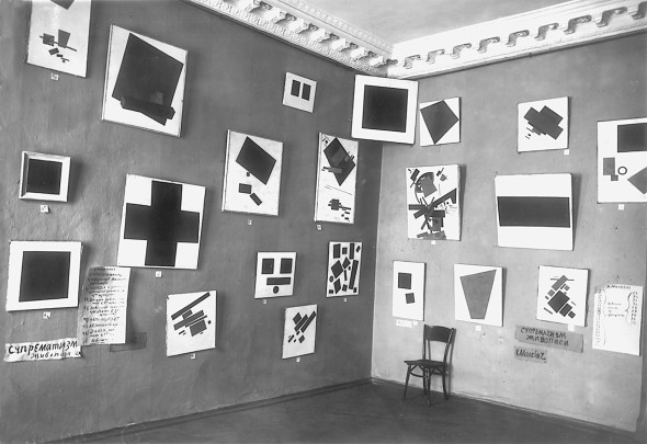 """""""0,10 – The Last Futurist Exhibition of Painting"""", Petrograd, winter 1915/16 View of the room with Malevich's Black Square and other suprematist paintings Russian State Archive for Literature and Art, Moscow"""
