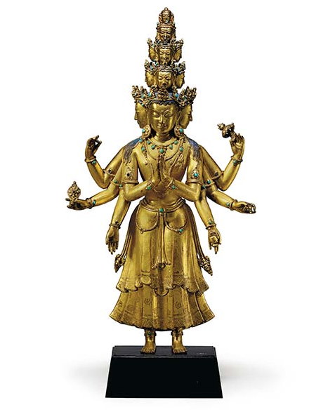 A Gilt Bronze Figure of an Eleven-Headed Avalokiteshvara Tibet, 15th/16th century Exquisitely modeled and standing with his two principle hands in front of his chest in anjalimudra and holding various implements in his six radiating hands, including a chakra, lotus blossom and water pot, dressed in a pleated two-tier ankle-length dhoti incised with a floral pattern, adorned with jewelry festoons and an antelope skin draped over the left shoulder, the eleven faces arranged in tiers, each surmounted by a jeweled tiara, the primary head with cascading locks of hair, the face with almond shaped eyes and bow-shaped mouth, the verso with a sealed consecration chamber, richly gilt overall with polychromy remaining 12 ½ in. (31.75 cm.) high Estimate (Set Currency) $300,000 – $500,000 SAVE AS INTEREST FOLLOW PLACE BID Sale Information SALE 12168 — INDIAN, HIMALAYAN AND SOUTHEAST ASIAN WORKS OF ART 15 March 2016 New York, Rockefeller Plaza