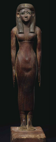 "AN IMPORTANT EGYPTIAN WOOD FIGURE OF A LADY MIDDLE KINGDOM, EARLY 12TH DYNASTY, CIRCA 1981-1802 B.C. Superbly sculpted, depicted standing with her feet together, the separately-made arms at her side and pinned in place with wood dowels, her long delicate fingers with white-painted nails, wearing a tightly-fitted sheath dress, revealing the form of her body beneath, with straps covering her breasts, ornamented with elaborate bracelets and anklets, her triangular face with inlaid eyes of white and black stone, presumably alabaster and obsidian, framed in copper, with a slender nose, a slightly-smiling mouth and a pointed chin, with a voluminous, striated, tripartite wig, painted black, on a deep integral plinth pinned in place into the rectangular base, the base painted red over white, with a black-painted hieroglyphic inscription, the Hetep-di nesu formula, partially preserved, reading ""An invocation of bread and beer, oxen and fowl, for the Ka of ...hetep, justified"" 10 ¾ in. (27.3 cm.) high Estimate (Set Currency) $500,000 – $700,000"
