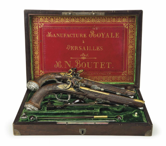 A MAGNIFICENT & IMPORTANT CASED PAIR OF FRENCH SILVER-MOUNTED RIFLED FLINTLOCK PISTOLS BY NICOLAS-NOEL BOUTET, VERSAILLES, THE CASE DATED '1825' With blued and gilt swamped octagonal barrels each cut with multi-groove rifling and decorated with gold-inlaid bands and finely engraved panels of foliage and Empire-style ornament, engraved and gilt breeches each struck with three maker's marks, engraved and gilt tangs decorated en suite, silver fore-sights, blued flat bevelled locks each with roller, gold-lined rainproof priming-pan and fine gold-encrusted ornament involving foliage, a dragon and a wolf, the lower edge of each lock respectively signed 'N.N. BOUTET A VERSAILLES' and 'MANUFACTURE ROYALE A VERSAILLES' in gold, each with set trigger mounted on an engraved iron trigger-plate, exquisite silver mounts cast and chased with Classical ornament against a stippled gilt ground, comprising trigger-guards each with trophy of arms finial and winged deity with laurel wreath, rear ramrod pipes each with Medusa mask, pommels each with Hercules mask, and side-plates each depicting the mythical fight between the Centaurs and Lapiths at the wedding feast of Peirithous, original silver-mounted ramrods, and each with gold escutcheon mounted behind the barrel tang bearing the name 'BOLIVAR', in silver-bound close-fitted veneered case lined in green velvet, the lid with tooled and gilt red Morocco lining signed 'MANUFACTURE ROYALE / à / VERSAILLES / 1825 / N.N. BOUTET / Le Dépôt de La Manuf.re a Paris. Rue Des Filles St. Thomas No.23', the exterior with silver escutcheon signed 'N.N. BOUTET A VERSAILLES' with accessories including silver-gilt-mounted powder-flask with sprung nozzle and case-hardened bullet-mould, Paris silver marks for circa 1809-1818 16 3/8 in. (41.5 cm.) overall, 10 5/8 in. (27 cm.) barrels; the case 17 ¾ in. (45 cm.) x 12 ¼ in. (31 cm.) Estimate (Set Currency) $1,500,000 – $2,500,000