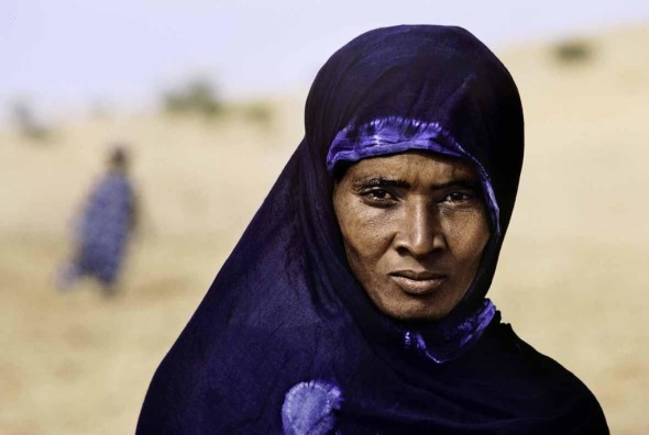 00365_12, Tuareg woman, Gao, Mali, 1986, MALI-10006  The Tuareg are a semi-nomadic tribe who live within the Sahara desert. For much of the year they move with their herd, but they often inhabit regions for fixed periods when they grow crops. Traditionally, the tribe is very insular, and one can detect wariness in the way this woman returns McCurry's gaze.  Magnum Photos, LON73479, MCS1986006K135  Phaidon, Iconic Images, final book_iconic, page 220.   final print_Milan book_The Unguarded Moment book_Iconic Photograhs book_PORTRAITS final print_Genoa final print_Perugia retouched_Sonny Fabbri 10/7/2013
