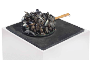 Lot 14 B Marcel Broodthaers (1924-1976) Poêle de moules  mussel shells, frying pan and resin on painted wooden base 7 3/4 x 20 1/4 x 17 3/4 in. (19.7 x 51.4 x 45.1 cm.) 	estimate $350,000 - $450,000  PRICE REALIZED USD 439,500