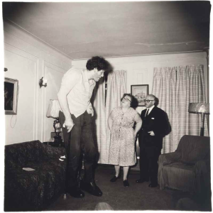 Lot 25 B DIANE ARBUS (1923-1971) A Jewish giant at home with his parents in the Bronx, N.Y., 1970 gelatin silver print image: 14 5/8 x 14 3/8 in. (37.2 x 36.5 cm.) sheet: 20 x 16 in. (50.8 x 40.7 cm.) 	estimate $300,000 - $500,000  PRICE REALIZED USD 583,500
