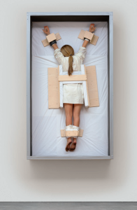 Lot 53 B Maurizio Cattelan (B. 1960) Untitled resin, paint, human hair, clothing, packing tissue, wood and screws 92 3/8 x 54 3/8 x 20 7/8 in. (234.6 x 138.1 x 53 cm.) estimate $1,000,000 - $1,500,000  PRICE REALIZED USD 1,507,500