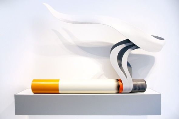 "Galerie Gmurzynska Smoking Cigarette #1 Tom Wesselmann Oil on wood and masonite, formica base 127 x 186.7 x 25.4 cm 50 x 73.5 x 10 inches Signed, titled, dated and inscribed on the reverse of the ""smoke"" element: ""Smoking Cigarette #1, Wesselmann 80 ©"""