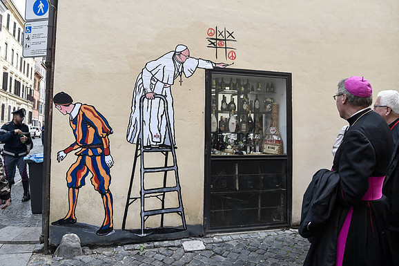 Super Pope - Street Artist Pope Reuters.com/AFP PHOTO/TIZIANA FABI