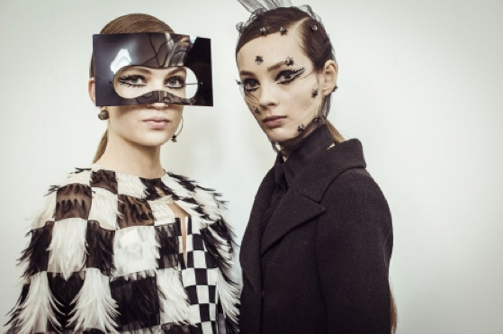 Dior's models sporting headpieces and checks from surrealist art