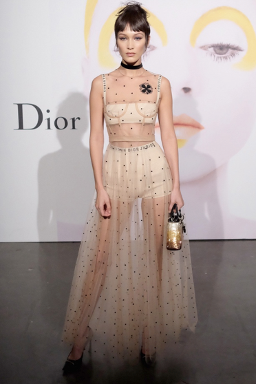Bella Hadid wears the iconic transparent dress at a Dior event in 2016.