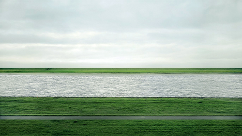 ANDREAS GURSKY (B. 1955)  Rhein II  signed 'Andreas Gursky' (on a paper label affixed to the backing board)  chromogenic color print face-mounted to Plexiglas  image: 73 x 143 in. (185.4 x 363.5 cm.) overall: 81 x 151a x 2 in. (207 x 385.5 x 6.2 cm.) Executed in 1999. This work is number one from an edition of six.  Other works from this edition are in the collection of the Museum of Modern Art, New York; Pinakothek der Moderne, Munich; Tate Modern, London and the Glenstone Collection, Potomac.  Price realised USD 4,338,500 Estimate USD 2,500,000 - USD 3,500,000 Post-War Contemporary Evening Sale New York|8 November 2011