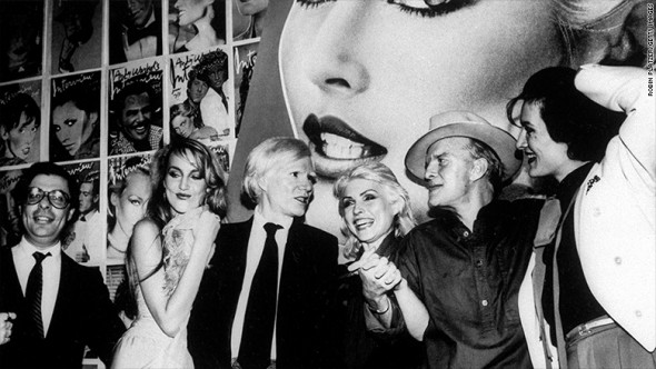 (L-R) Editor Bob Colacello, model Jerry Hall, artist/publisher Andy Warhol, singer Debbie Harry, writer Truman Capote and jewelry designer Paloma Picasso at a Studio 54 party for INTERVIEW magazine and Harry's appearance on the cover. (Photo by Robin Platzer/Twin Images/The LIFE Images Collection/Getty Images)
