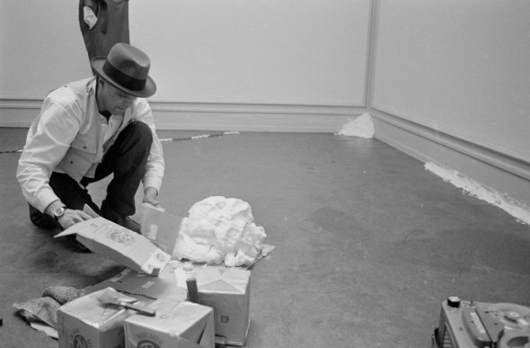 "Joseph Beuys working on Fettecke, 1969 ""When Attitudes Become Form"" Kunsthalle Bern, 1969 Courtesy The Getty Research Institute, Los Angeles (2011.M.30) Photo: Balthasar Burkhard © J. Paul Getty Trust"
