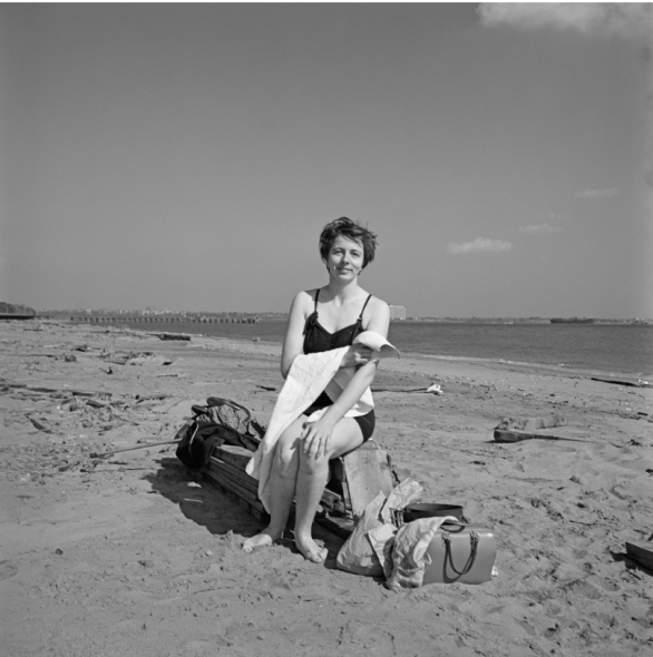 Vivian Maier, Self-portrait on a beach in New York's Staten Island, 1954_ Image size: 12x12 inch (30,48 x 30,48 cm) Paper size: 20x16 inch (50,8 x 40,64 cm) ©Estate of Vivian Maier, Courtesy of Maloof Collection and Howard Greenberg Gallery, NY