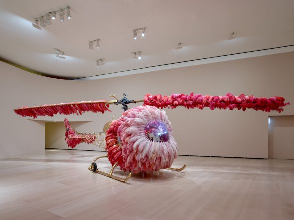 Joana Vasconcelos, Lilicoptère, 2012 Bell 47 helicopter, ostrich feathers, Swarovski crystals, gold leaf, industrial paint, Dyed leather upholstery embossed with fine gold, Arraiolos rugs, walnut wood, woodgrain painting, and passementerie