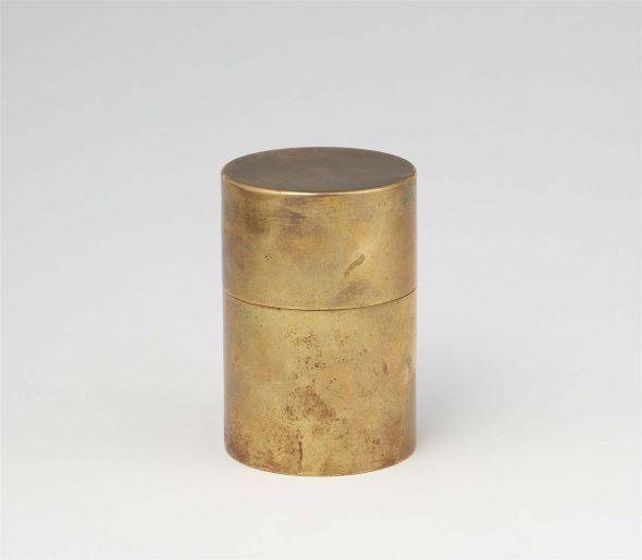 A Bauhaus brass box Cylindrical, the upper section forming the tightly fitting slip lid. Impressed mark BAUHAUS. H 9, D 6 cm. Attributed to Hans Przyrembel, Bauhaus metal works, Dessau, circa 1926.