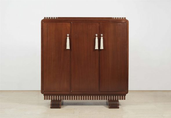 "A library cabinet ""bibol trois pleines"" Wild service tree on mahogany corpus, ivory, and metal mountings. H 151.5, W 147.5, D 55 cm. After a design by Jacques-Émile Ruhlmann, circa 1923, possibly produced by Alfred Porteneuve."