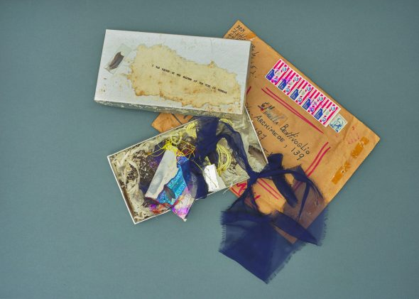 AMELIA ETLINGER, Untitled (I was caught by the feather of the wind of Mirella),box, feather, and mixed media on paper, Courtesy Osart Gallery , Photo: Max Pescio